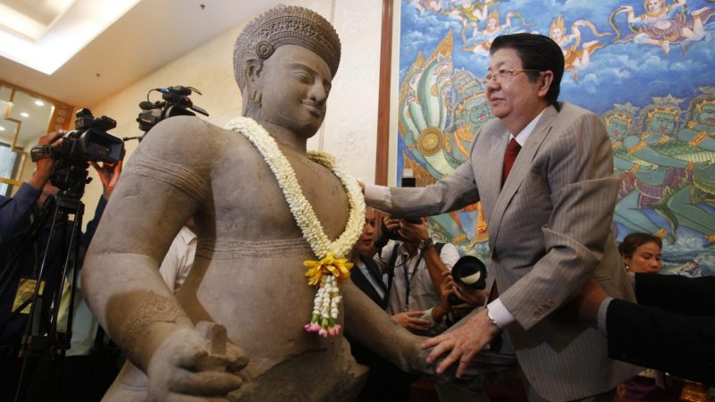 International art expert charged with selling looted Cambodian antiquities for the past 50 years